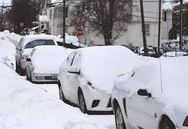 Picture of snow covered cars along street
